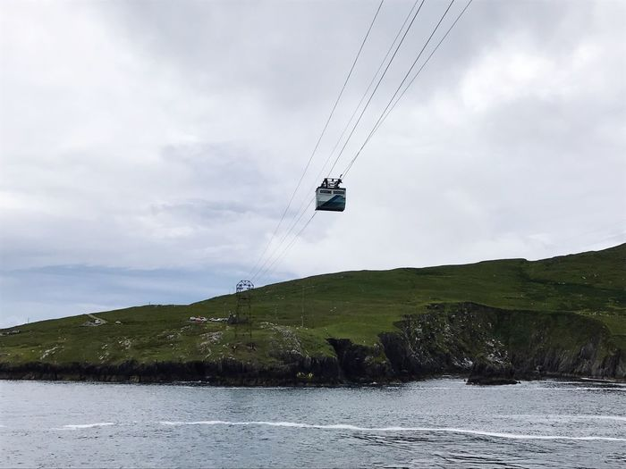 Sky Water Nature Cloud - Sky Day Cable Waterfront Scenics Mountain Overhead Cable Car Low Angle View Outdoors Beauty In Nature Landscape No People Tree Ski Lift
