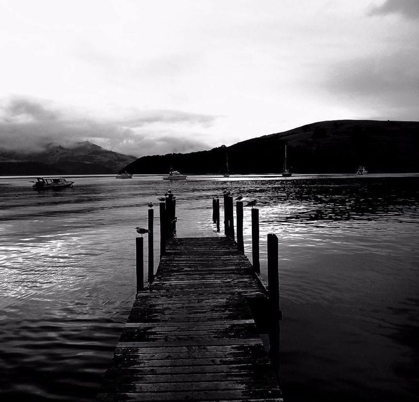 Sometimes the hardest roads lead to the most beautiful locations... My Photography Seaside Wharf Sea Black & White Peace And Quiet No People Outdoors Scenery Mindfulness Water Boats Beach Winter Photography Black Color Magic