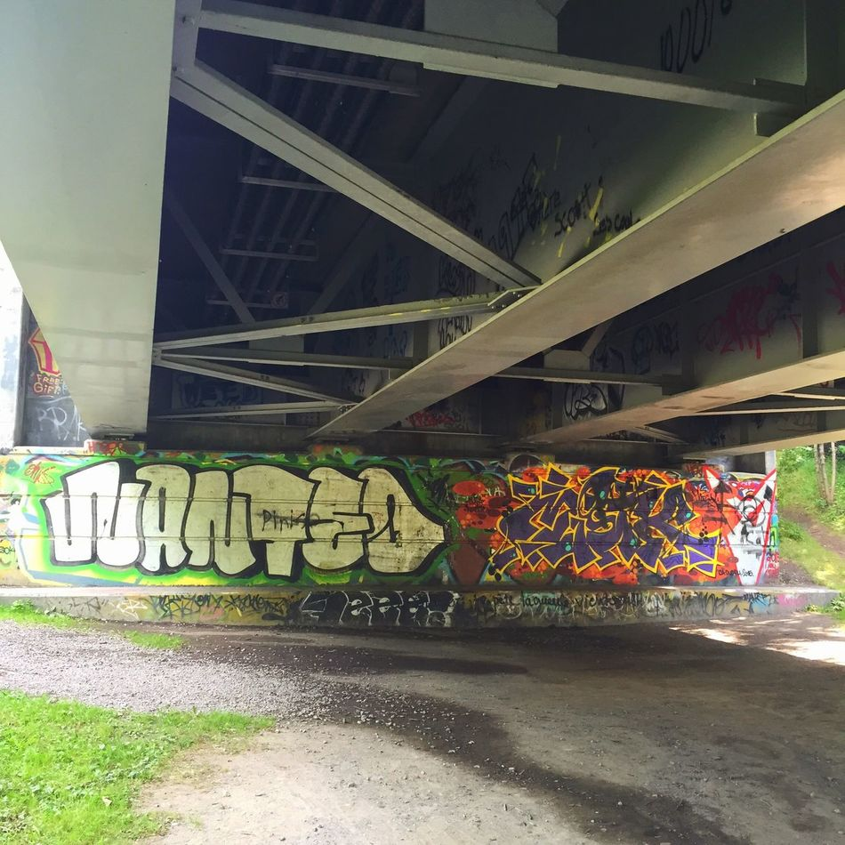 Underneath the bridge The tarp has sprung a leak... Graffiti
