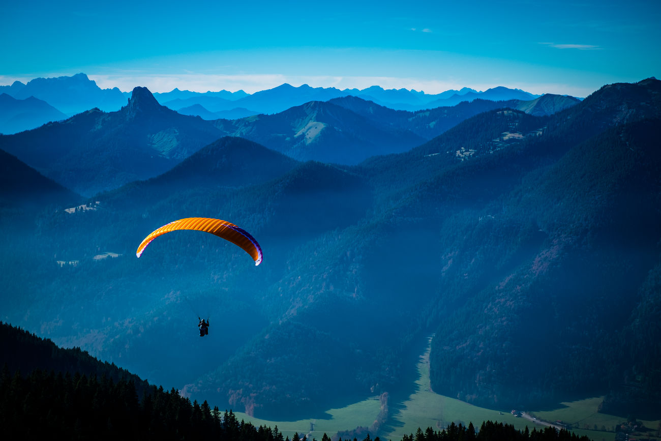 Fly away Mountain Flying Mountain Range Landscape Paragliding Blue Extreme Sports Mid-air Scenics Beauty In Nature Sky Parachute Nature Cloud - Sky Adventure Sport Mountain Peak Outdoors Fujifilm Fuji Fujifilm_xseries Taking Photos Travel Mystyle