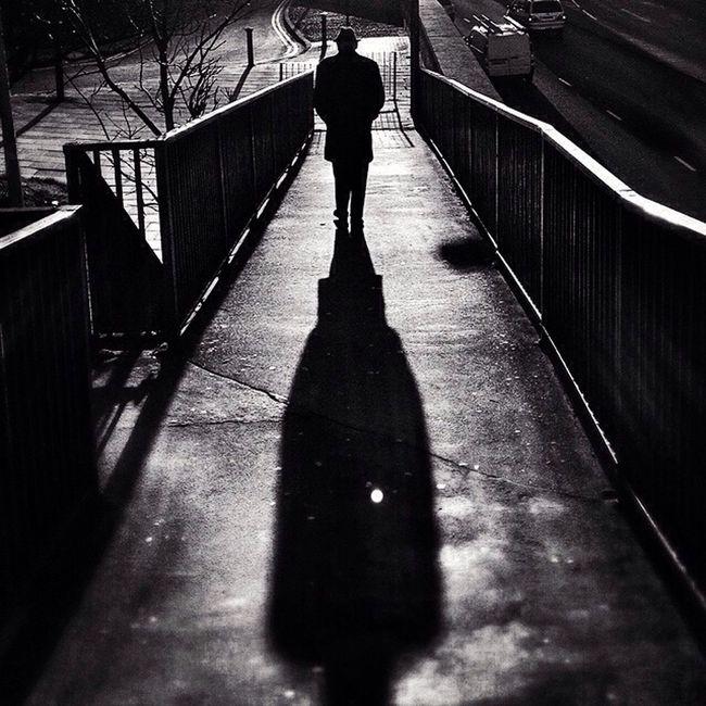 Commute Edit 4/14 Shadow Silhouette Blackandwhite Streetphotography London Monochrome Man Bwstreetphotography Hat Bridge