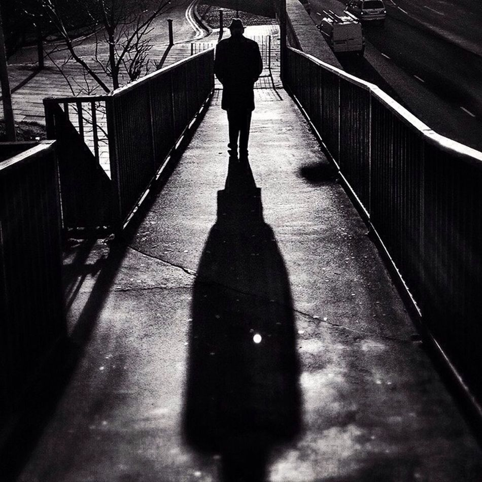 Commute Edit 4/14 Shadow Silhouette Blackandwhite Streetphotography London Monochrome Man Bwstreetphotography Hat Bridge