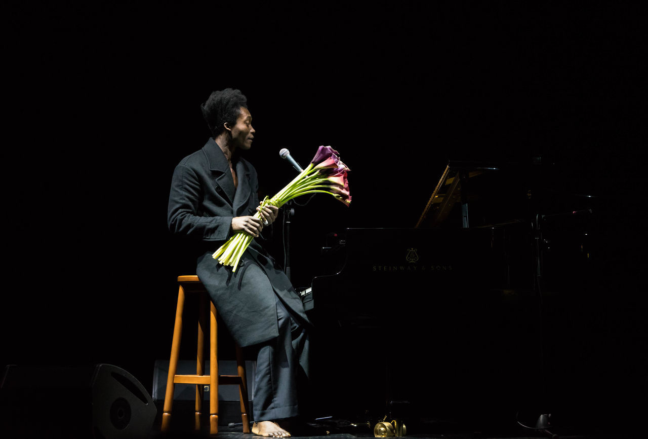 Performance of Benjamin Clementine in Kiev Ukraine Benjamin Clementine Black Background Concert Dark Night Occupation Performance Performance Art Person Piano Playing S Side View Sitting Standing Well-dressed