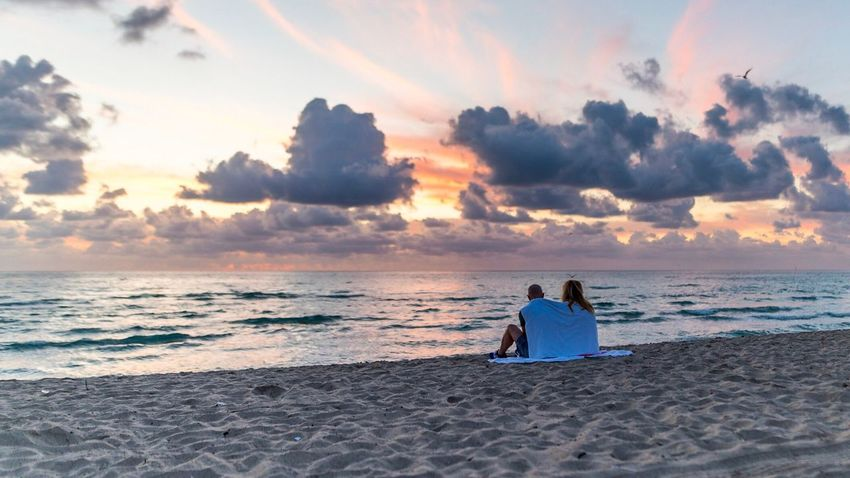 Sea Two People Sky Beach Horizon Over Water Sitting Men Rear View Cloud - Sky Water Sunset Outdoors Full Length Togetherness Sand Beauty In Nature Nature Real People People Adults Only