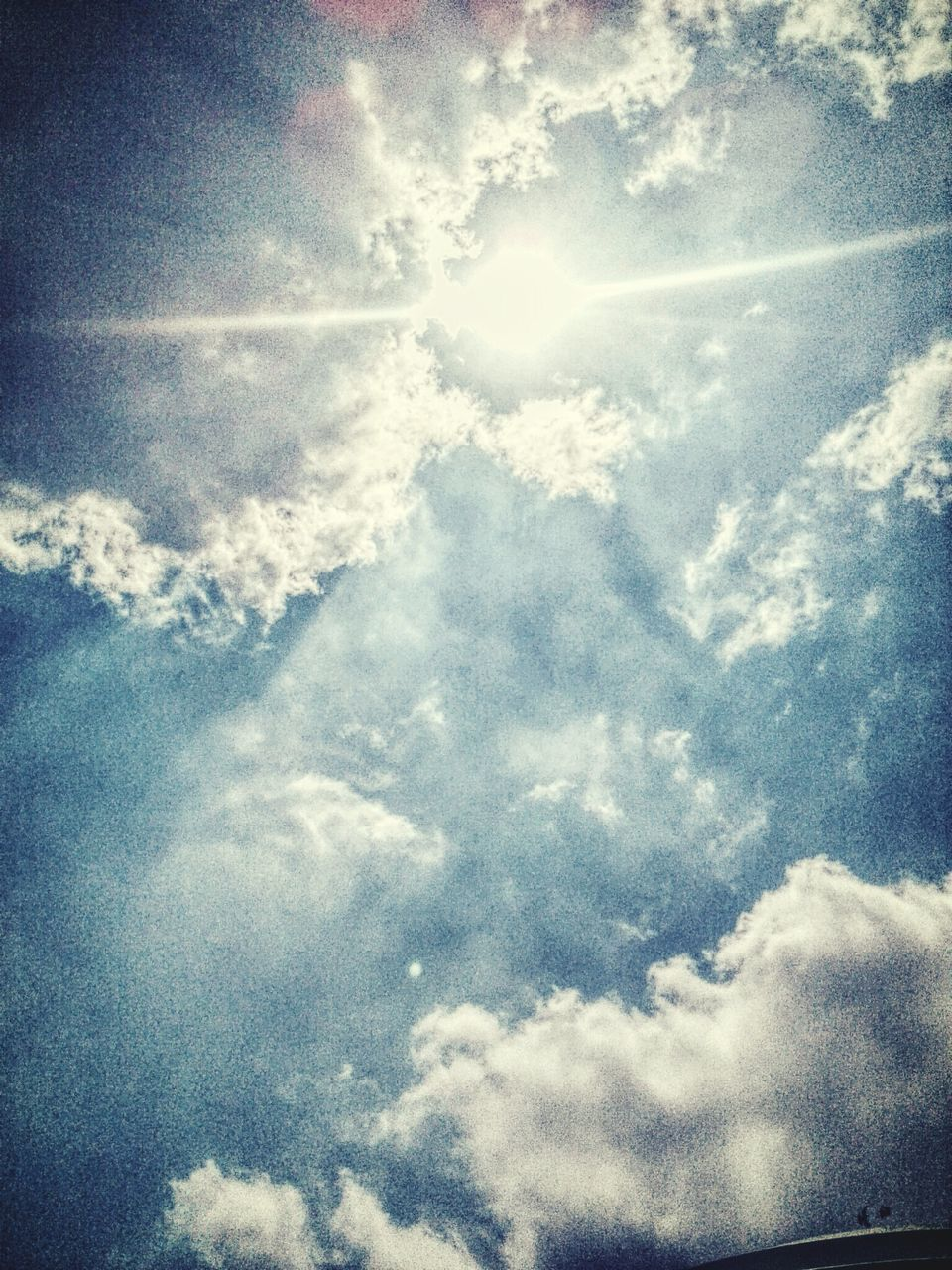 low angle view, sunbeam, beauty in nature, nature, sky, cloud - sky, majestic, sun, day, no people, scenics, tranquility, sky only, sunlight, outdoors, backgrounds