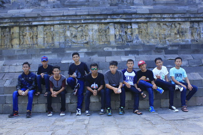 Borobudur temple Borobudur Casual Clothing Day Full Length Having A Good Time History Holidays Jogjakarta Outdoors Person Scenery Side By Side Sitting Stroll Study Tour Togetherness First Eyeem Photo