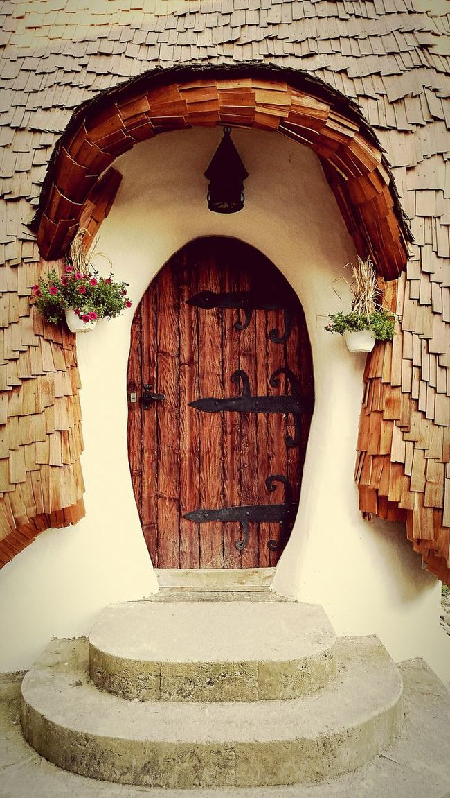 Doors Vintage Photo Vintage Doors Fairy Tale Old House Pretty Flowers Wodden Door Architecture Vintage Architecture New And Old House In Nature Followme Wood And Metal Stone Wall Stones Nature House By The River Architecture Details