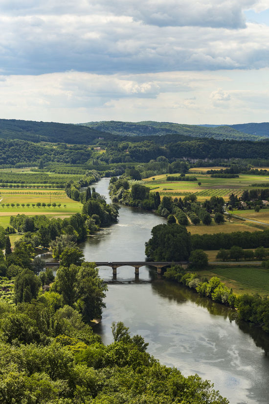 View of the Dordogne river from Domme, Sarlat-la-Canéda, Dordogne, Aquitaine, France Beauty In Nature Cloud - Sky Day Field Green Color Landscape Nature No People Outdoors River Scenics Sky Tranquil Scene Tranquility Tree Water