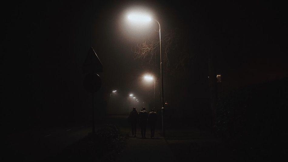 Strangers in the night. Illuminated Night Electricity  Street Light Traveling City Nightphotography Darkness And Light The Week Of Eyeem Dark 35mm Silhouette Night Lights Spotlight Neon Lights Street Streetphotography Group Outdoors