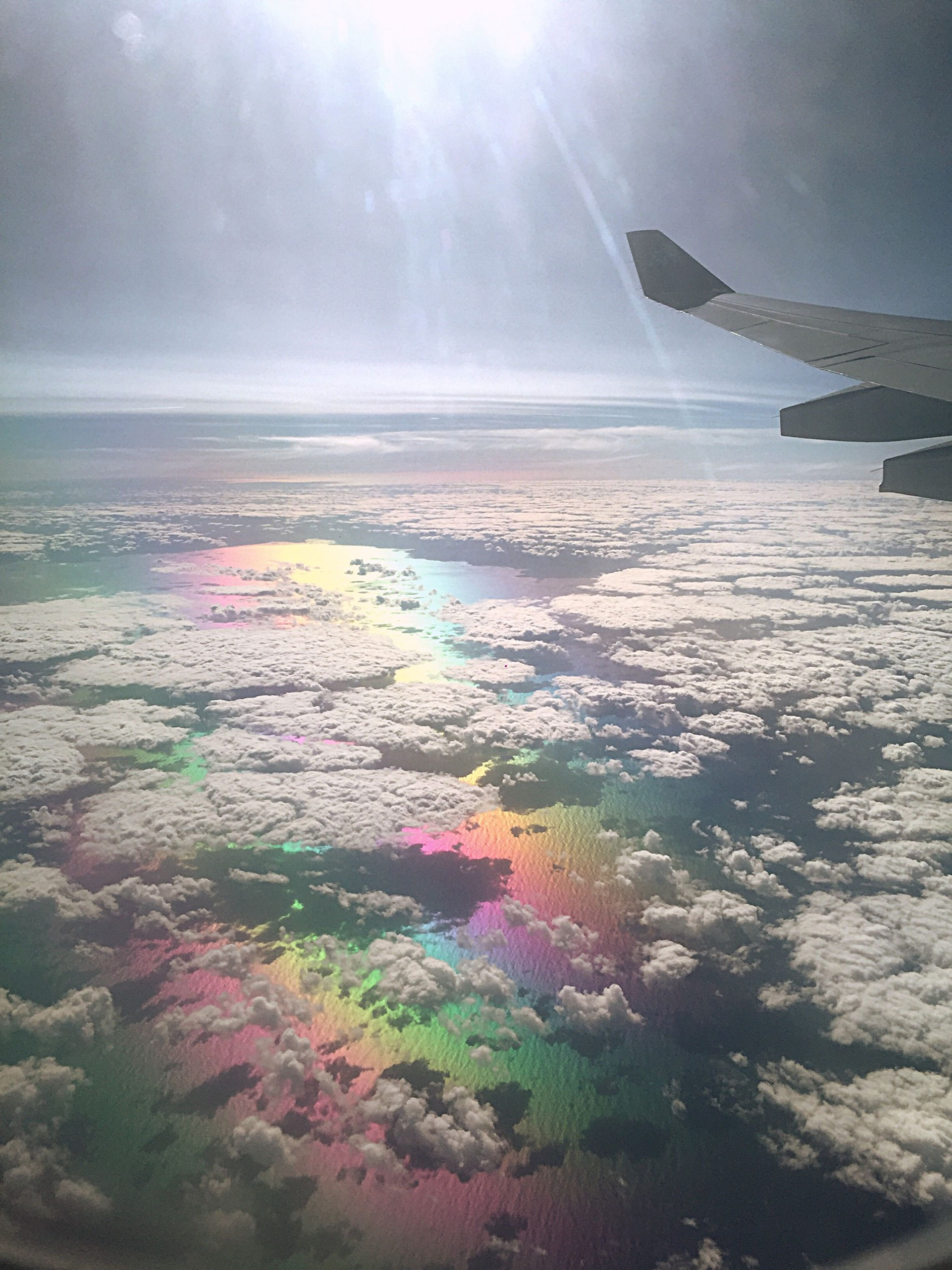 sea, aerial view, horizon over water, transportation, scenics, sky, beauty in nature, aircraft wing, mode of transport, flying, nature, airplane, tranquil scene, water, tranquility, travel, sunlight, sun, air vehicle, cloud - sky
