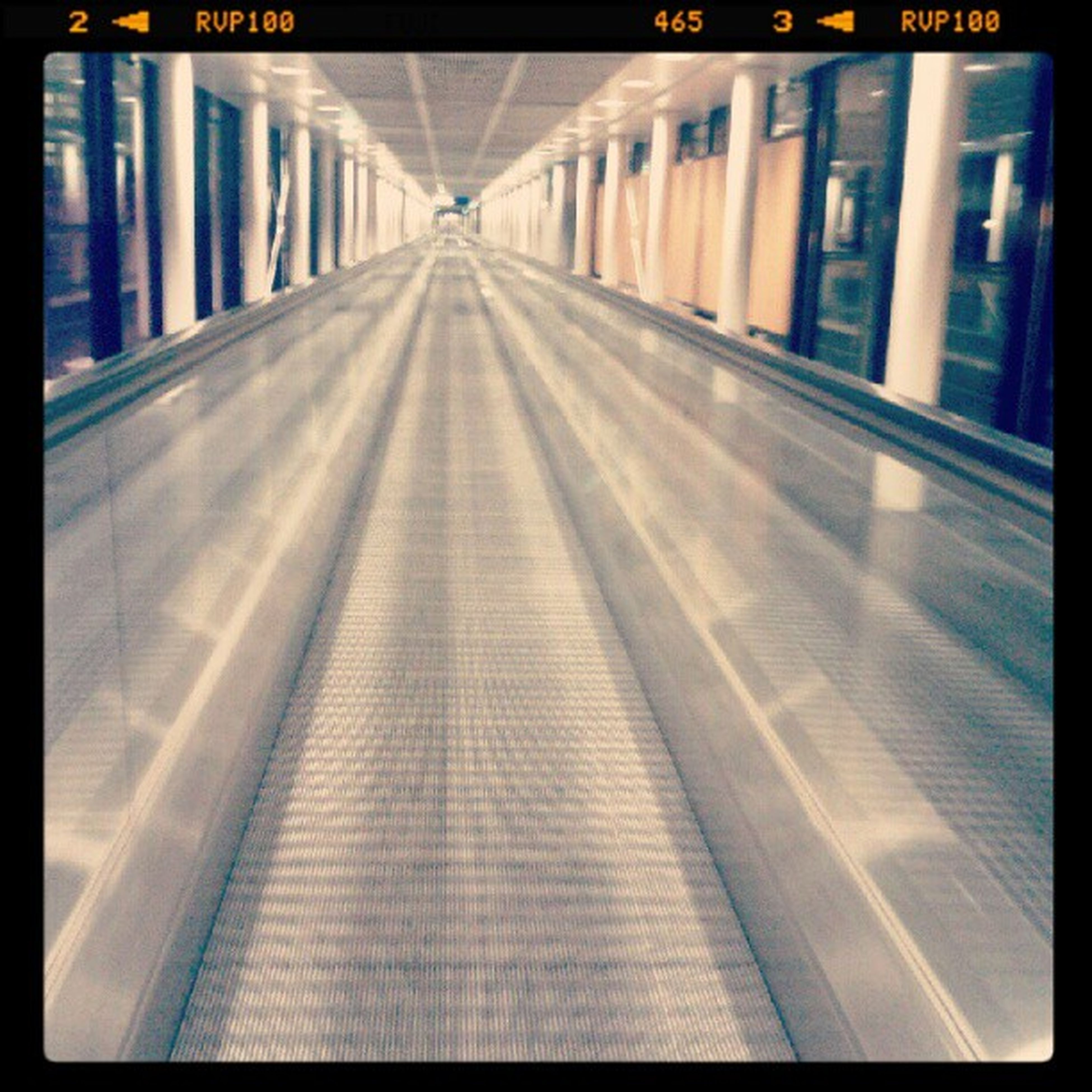 transfer print, the way forward, transportation, diminishing perspective, illuminated, architecture, railroad track, built structure, auto post production filter, railroad station platform, railroad station, indoors, rail transportation, vanishing point, public transportation, empty, travel, incidental people, city, night