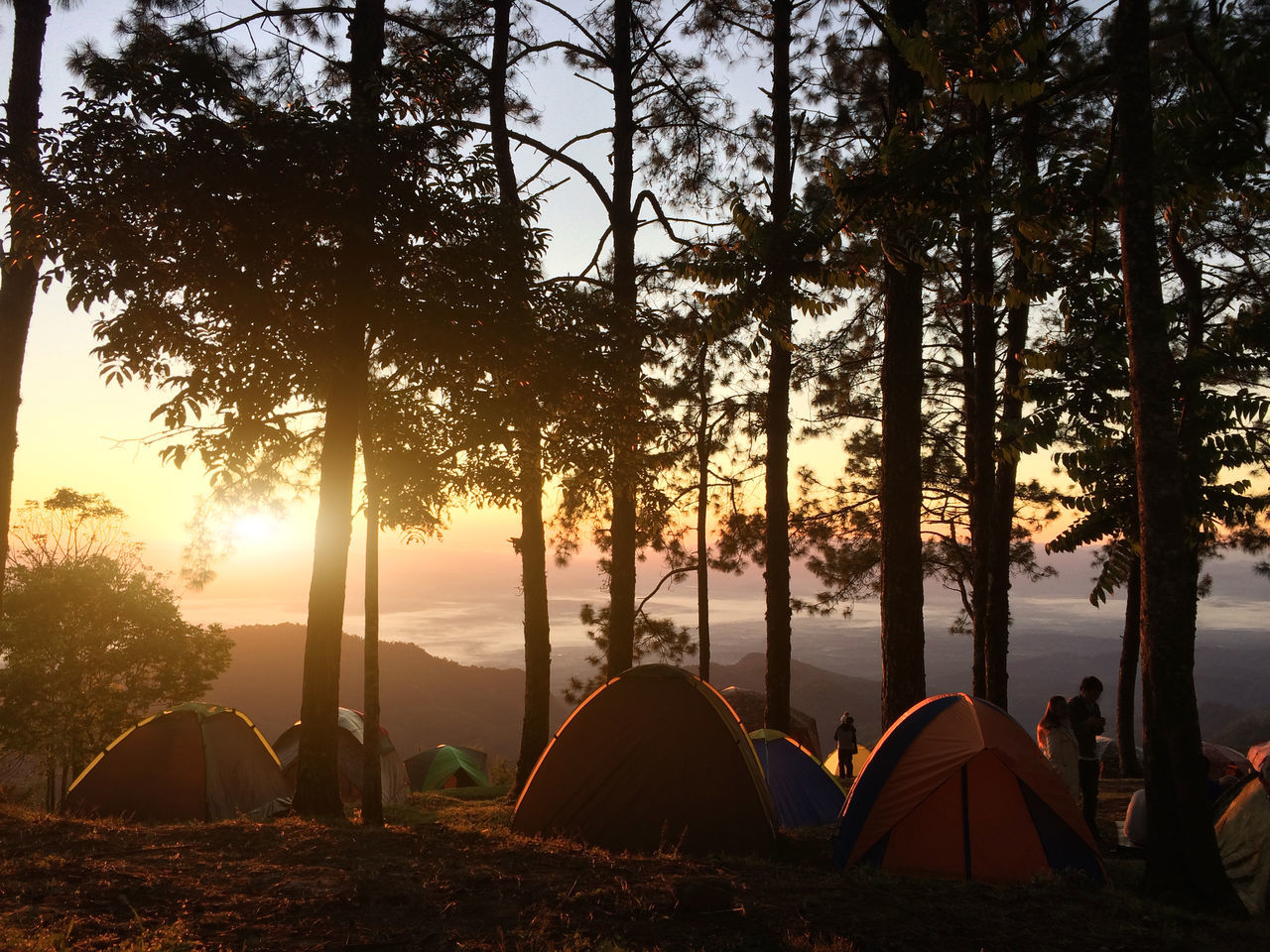 Camping over mountain with sunrise landscape. Adventure Beauty In Nature Camping Day Forest Landscape Nature No People Outdoors Scenics Shelter Silhouette Sky Sunlight Sunset Tent Tranquility Tree