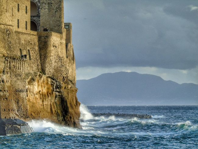 Sea Water Sky Nature No People Waterfront Beauty In Nature Day Outdoors Scenics Wave Architecture Breaking Waves Castle Castel Dell'ovo Naples Italy Photography Streetphotography EyeEmNewHere