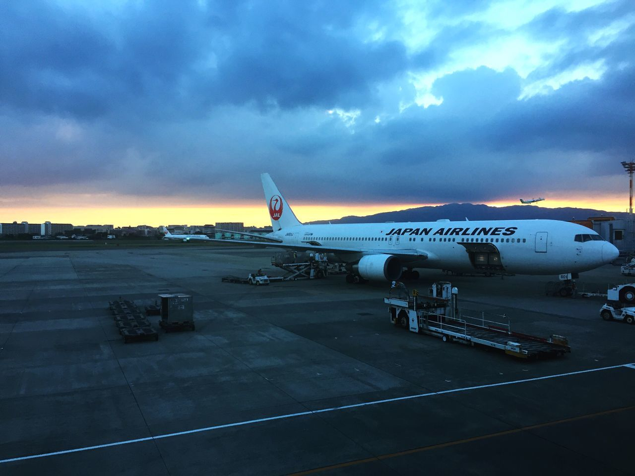 cloud - sky, airplane, transportation, airport runway, sky, sunset, airport, air vehicle, no people, mode of transport, outdoors, runway, commercial airplane, day, nature, airplane wing