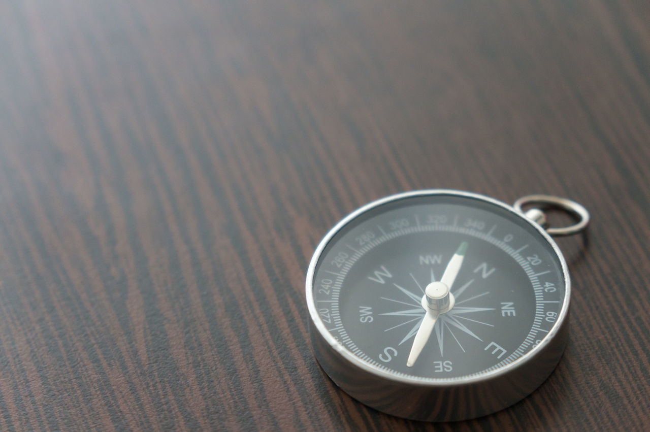 navigational compass, guidance, direction, table, no people, indoors, close-up, pocket watch, watch, time, day