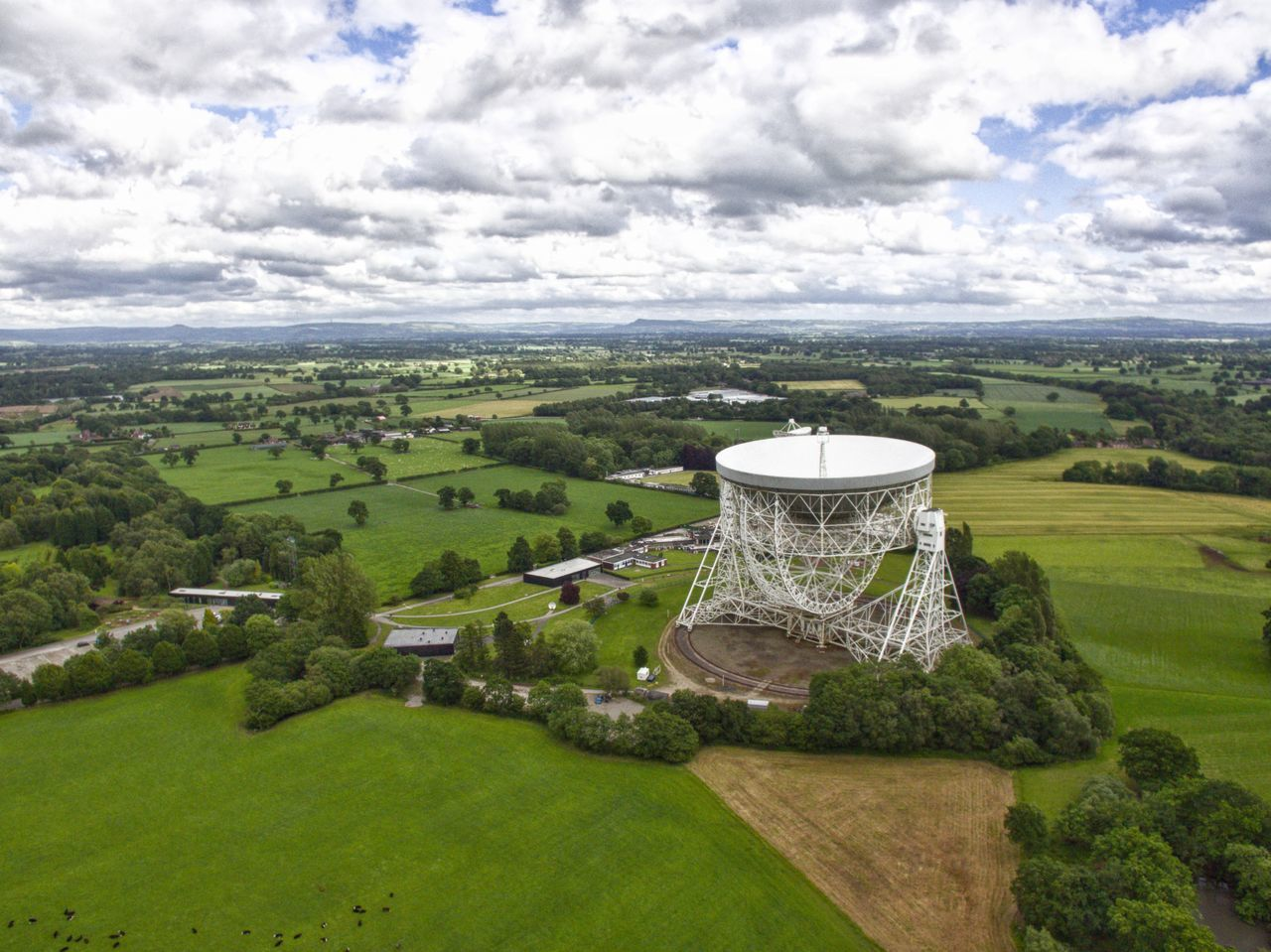 Jodrell Bank // Cloud - Sky Green Color Architecture Agriculture Scenics Beauty In Nature Field Landscape Built Structure No People Building Exterior Travel Destinations Tranquility Day Tree Nature Growth Sky Outdoors Grass Jodrell Bank Cheshire Dronephotography Dji Phantom Drone