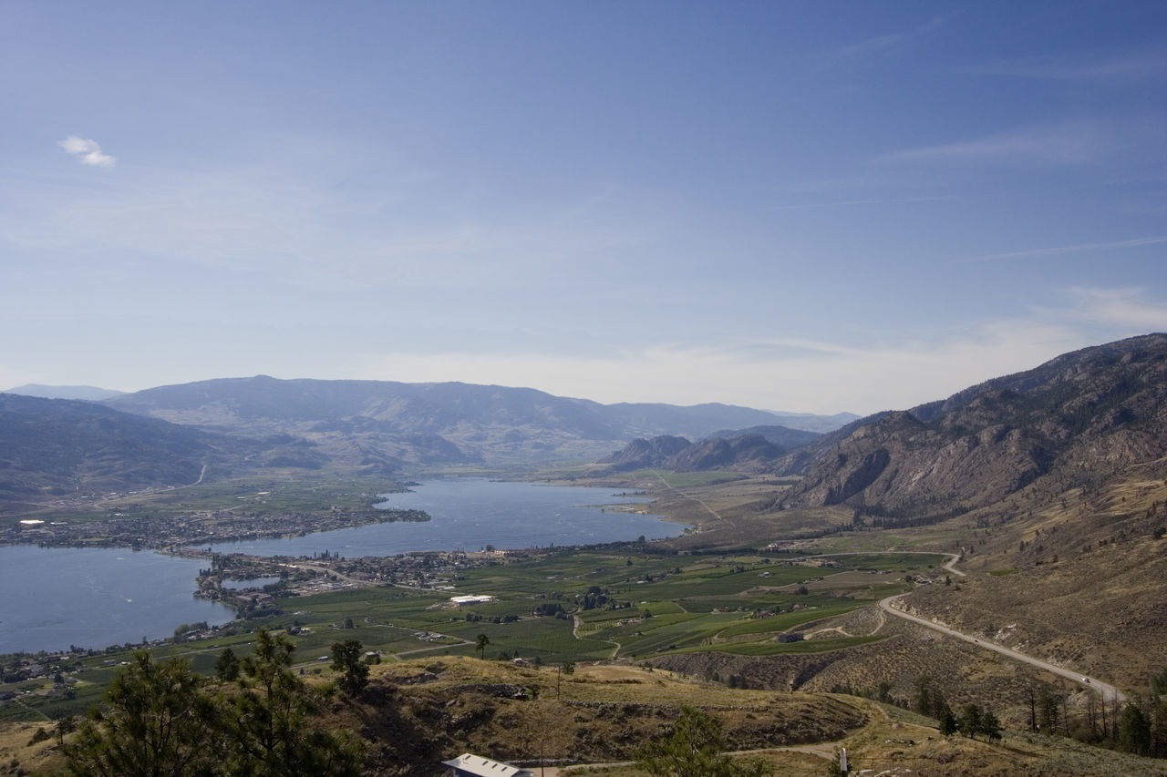 Lake Osoyoos, South of Britsh Columbia, Canada - view from the top - mountains, fields and rural scenery Aerial View Beauty In Nature British Columbia Canada High Angle View Lake Lake Osoyoos Lake View Lakeshore Lakeside Lakeview Landscape Landscape_Collection Landscape_photography Mountain Mountain Range Nature No People Osoyoos Osoyoos, BC Panorama Road Travel Destinations Vineyard Water