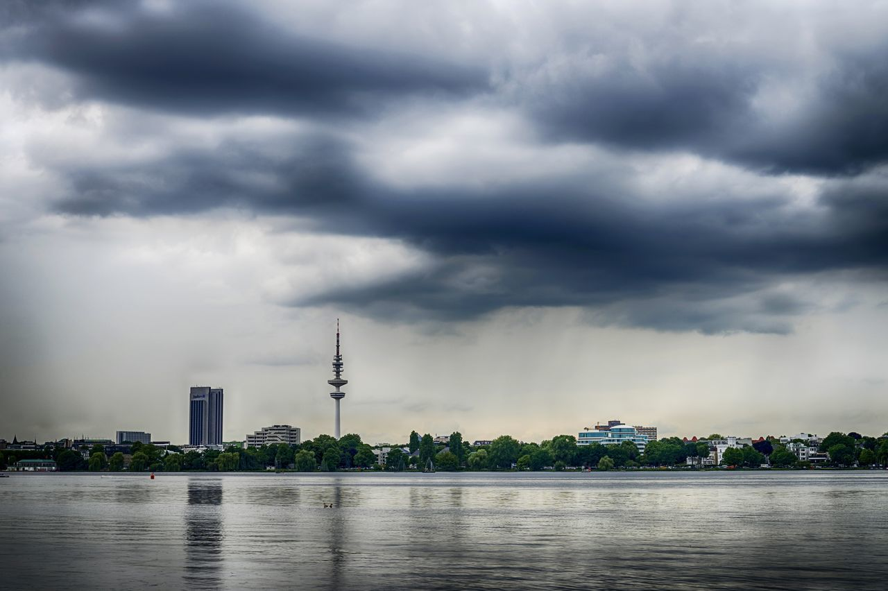 Architecture Beauty In Nature Building Exterior Built Structure City Cityscape Cloud - Sky Communication Day Global Communications Lake Nature No People Outdoors Sky Skyscraper Storm Cloud Technology Television Tower Alster Waterfront Water Urban Skyline Travel Destinations Tower