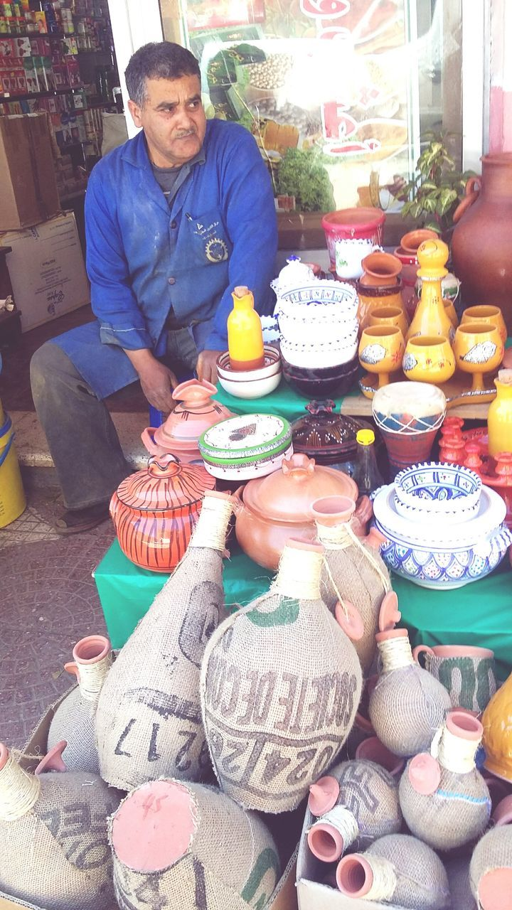 for sale, real people, choice, variation, retail, market, large group of objects, one person, day, food, multi colored, outdoors, men, freshness, people