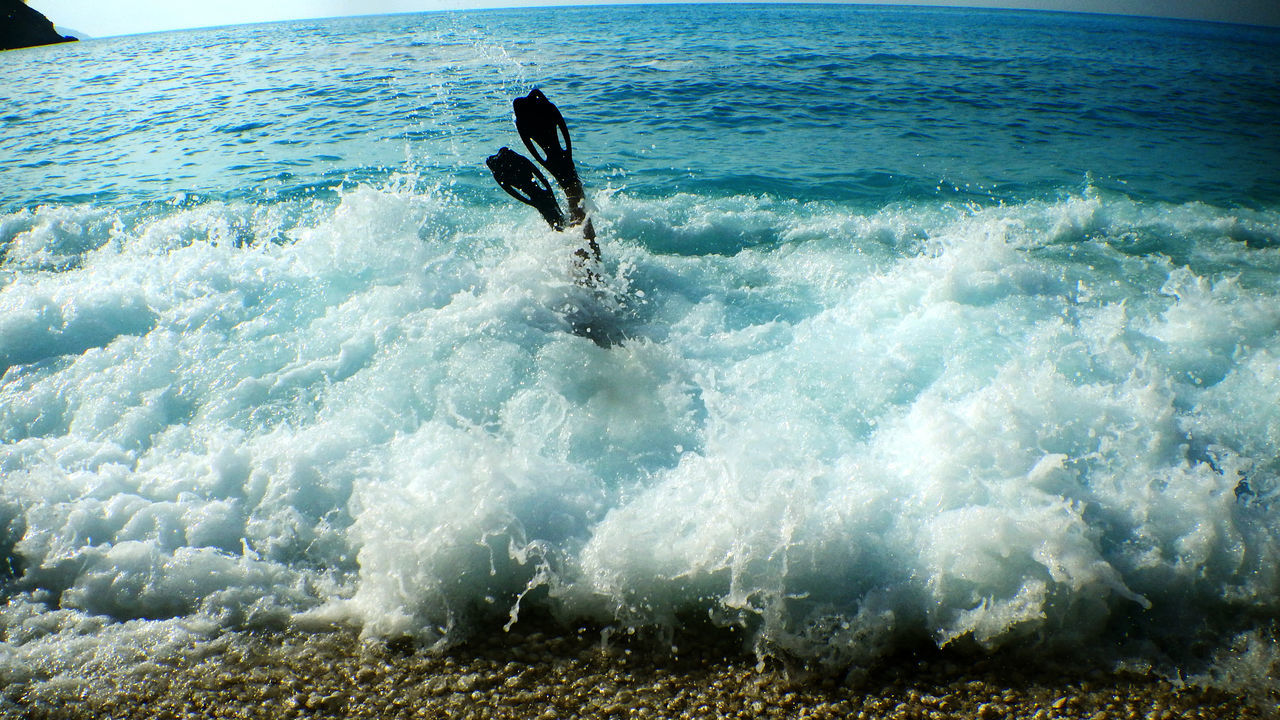 motion, sea, wave, one person, sport, nature, surfing, adventure, water, speed, men, extreme sports, real people, healthy lifestyle, outdoors, one man only, day, skill, vacations, beauty in nature, power in nature, sky, only men, people, adult, adults only