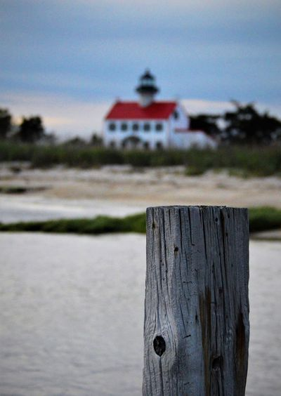 Dusk Sky Lighthouse Nature Architecture Bay Beach Built Structure Close-up Day Focus On Foreground Nature No People Outdoors Red Roofs Reeds Scenic View Sky Tall - High Water Wood - Material Wooden Post