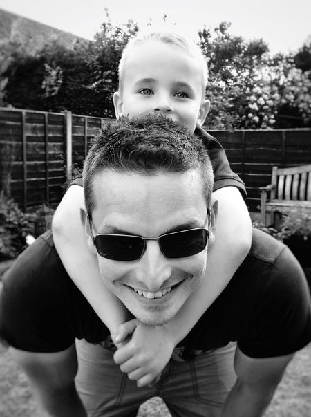 Looking At Camera Portrait Front View Fatherhood Moments Black And White Father & Son Piggyback Enjoyment Summer Outdoors Lifestyles ThatsMe IPhoneography