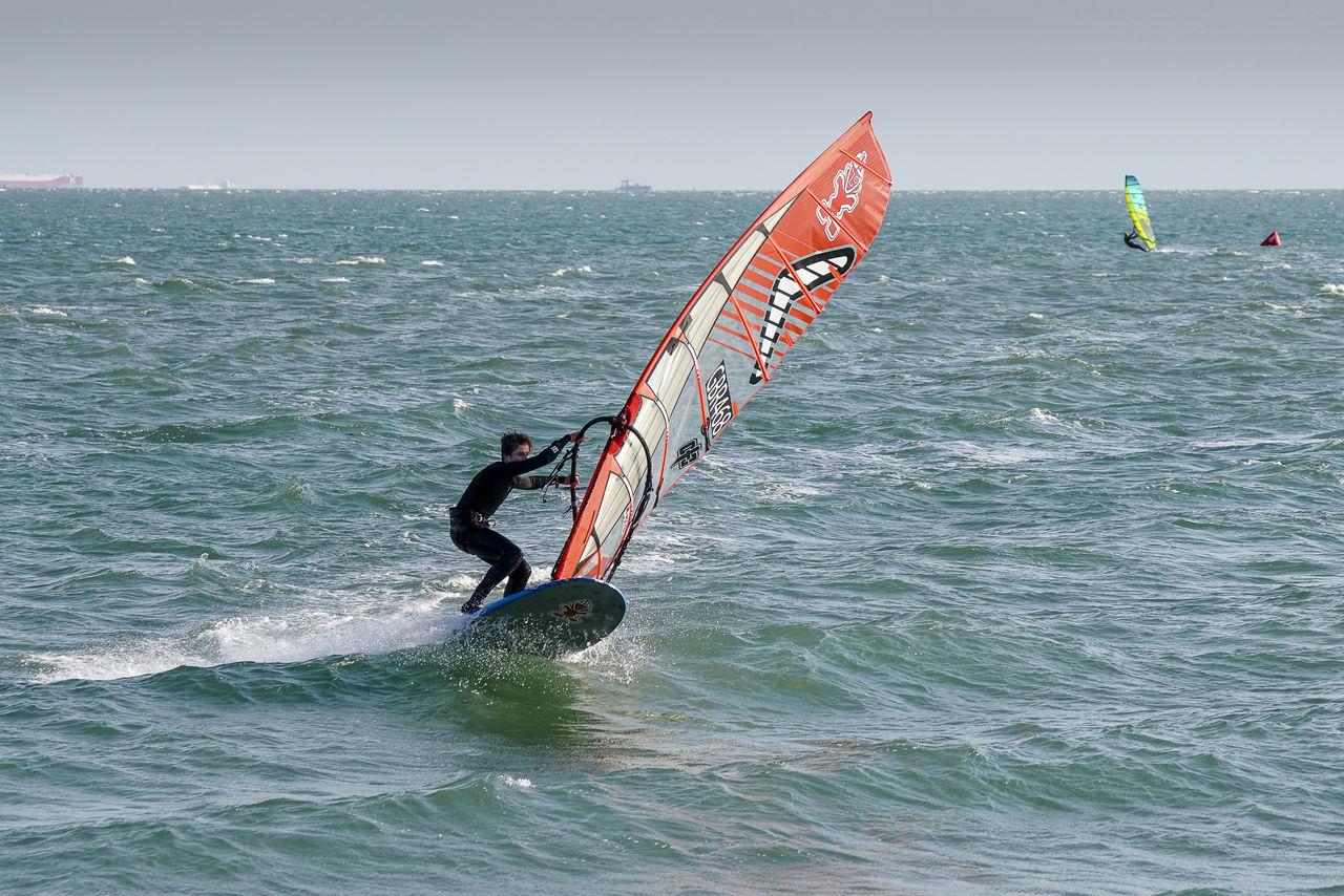 Windsurfers racing off Hayling Island sea front in Hampshire, UK. Coast England Europe GYBE Gybing Hampshire  Hants Hayling Island  Race Racing Sail Sailboard Sailboarding Sailing Sea Speed Uk Windsurf Windsurf Competition Windsurf Life Windsurfen Windsurfer Windsurfers Windsurfing Windy