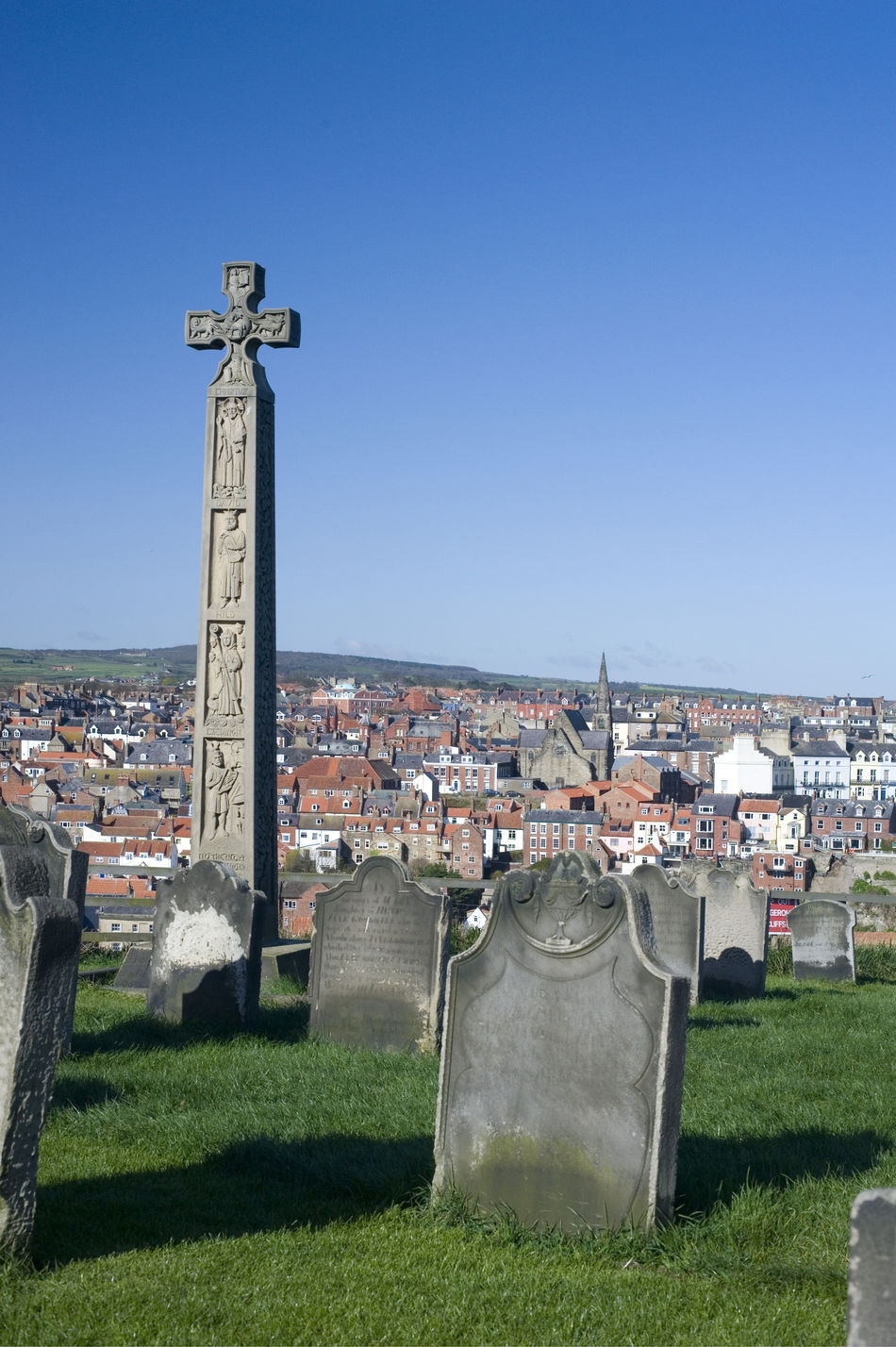Caedmons Cross, an ornately carved and inscribed stone celtic cross commemorating, Caedmon, an Anglo-Saxon, poet and songwriter, in St Marys Graveyard in Whitby Anglo-saxon Caedmon Caedmons Cross Carvings Celtic Clear Sky Cross England Graveyard Historical Inscribed Landmark Medieval Memorial Monkmonument North Yorkshire Ornate Poet Religion Sightseeing