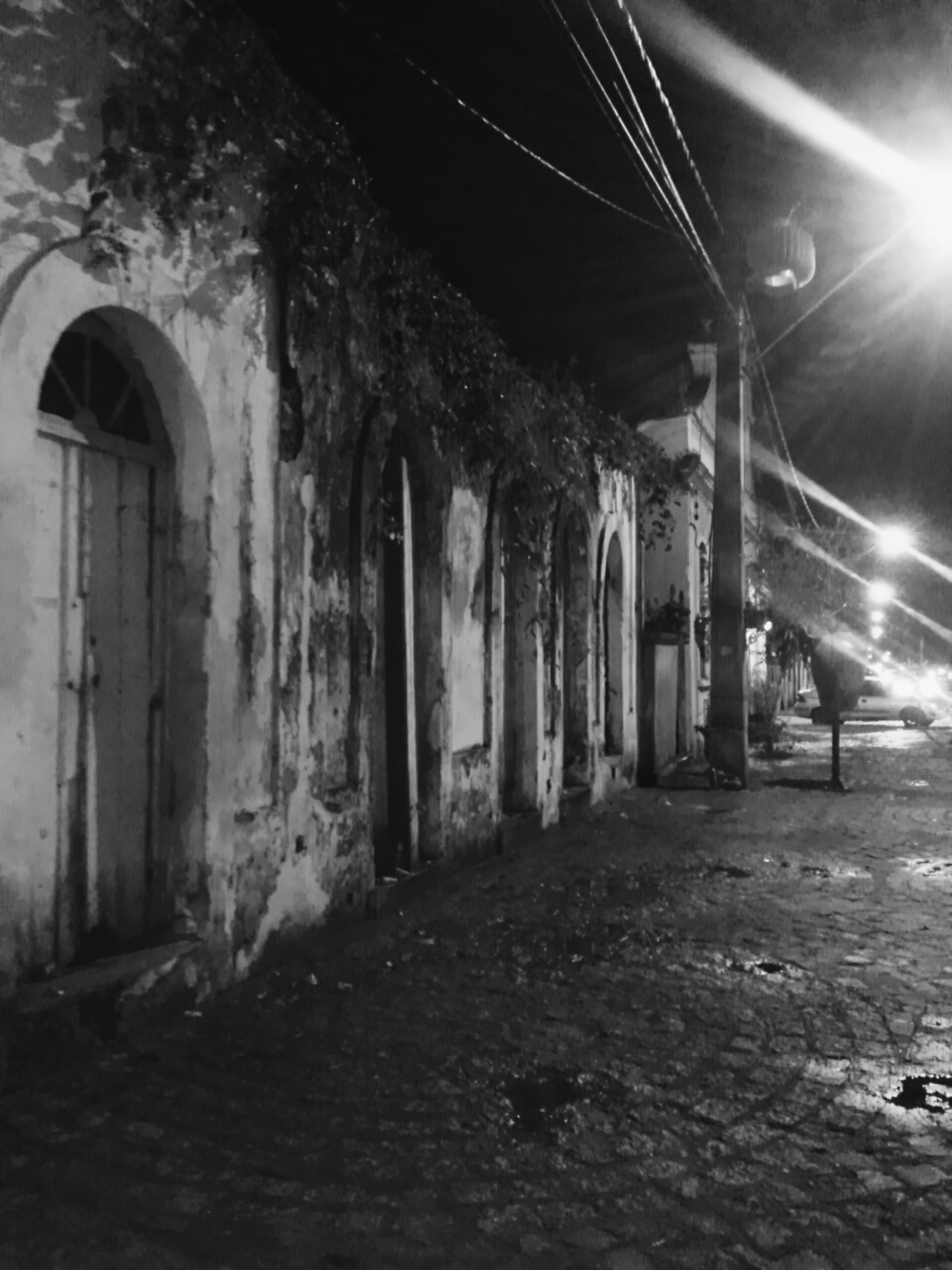 illuminated, architecture, built structure, night, abandoned, building exterior, lighting equipment, the way forward, old, damaged, building, indoors, obsolete, run-down, street, street light, deterioration, wall - building feature, tunnel, interior