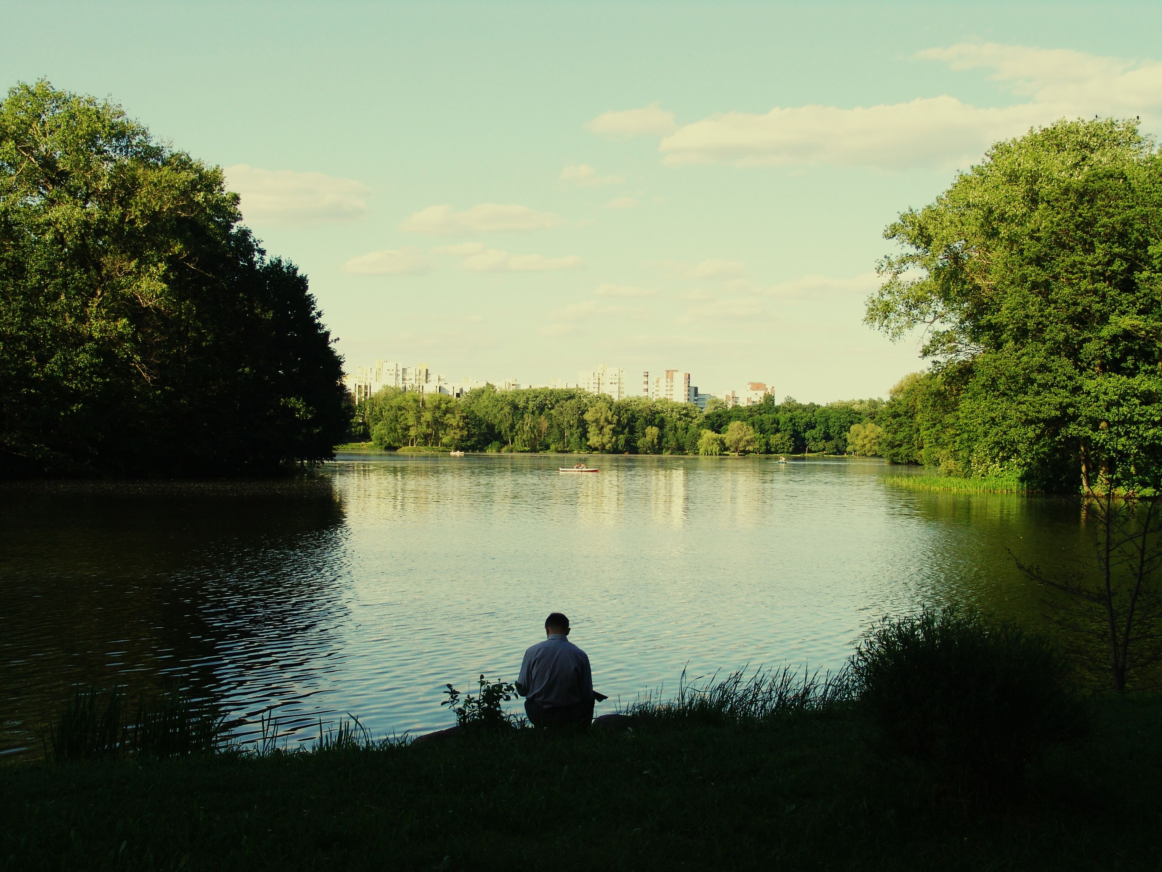 tree, water, lake, sky, tranquility, tranquil scene, rear view, nature, scenics, beauty in nature, leisure activity, reflection, silhouette, river, men, lifestyles, standing, lakeshore