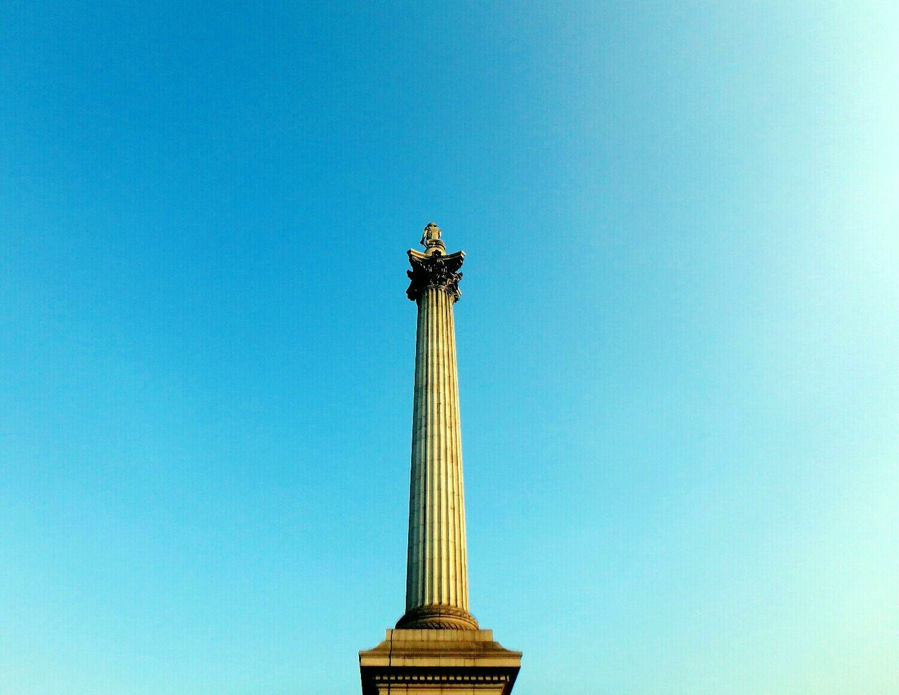 Low Angle View Of Nelson Column Against Clear Blue Sky