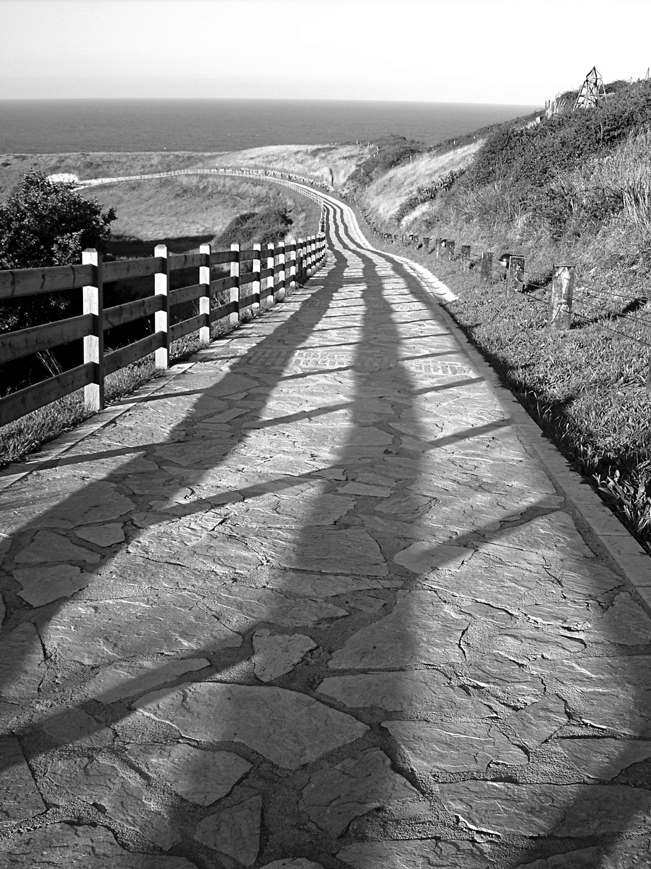 Beauty In Nature Blackandwhite Day Fence Footpath In A Row Light And Shadow Nature No People Outdoors Scenics Sea Sky Sunlight Tranquility EyeEm New Here