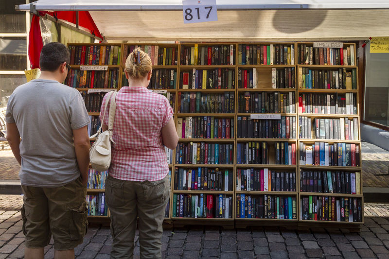 What book to buy Books EventPhotography Read Second Hand Street Market Book Bookmarket Cheap Dutch Education Educational Information Outside Outside Photography Paperback Paperback Novel People People And Places Publication Reading A Book Real People Streetphotography Sunny Day Urban Vintage