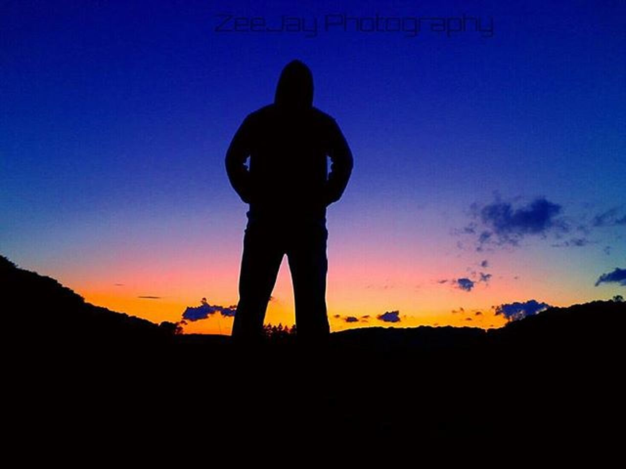 silhouette, sunset, standing, one person, one man only, sky, people, nature, only men, outdoors, beauty in nature, blue, full length, scenics, adults only, adult, men, day
