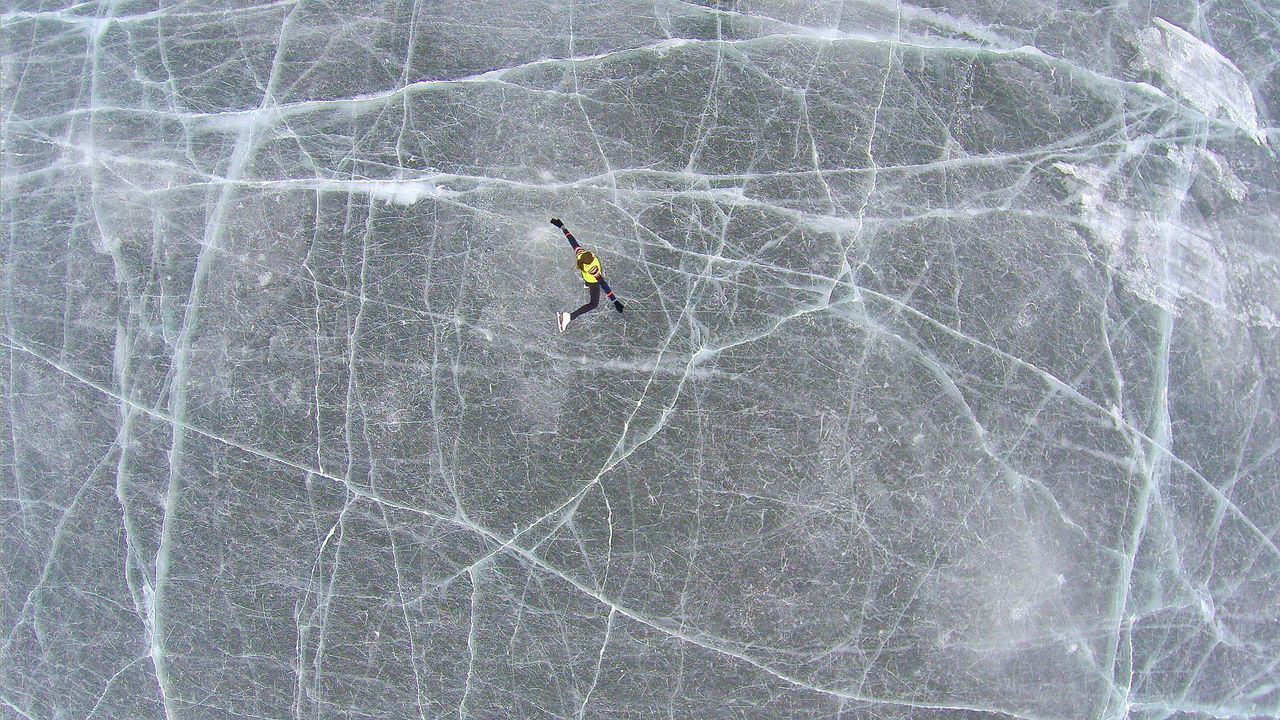 Aerial View Of Person Ice Skating