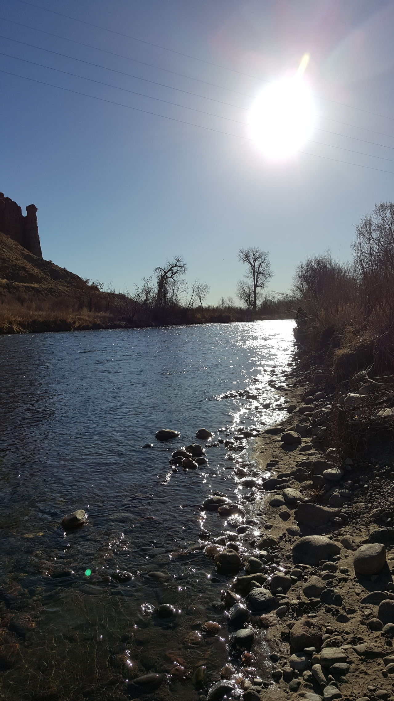 Sky No People Tranquil Scene Water Sea Outdoors Beauty In Nature Nature Scenics Tree Bird Stream Refraction Day River View Riverside Clearwater In Colorado Arkansas River Ice Around Stick River Rocks River Day Illuminated Blue Tree