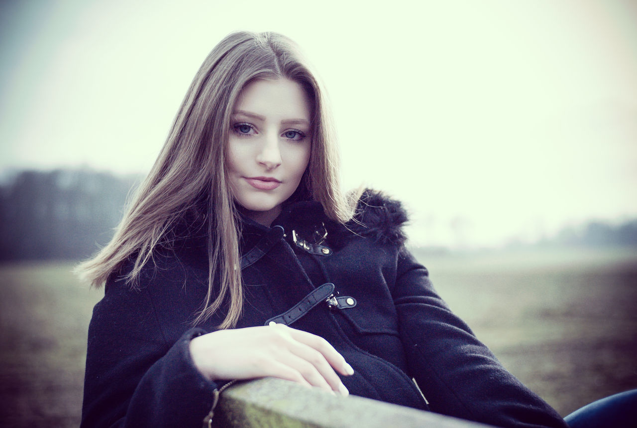Portrait of an attractive young woman. Beautiful Woman Caucasian European  Female Model Girl Headshot Lifestyles One Person Outdoors People Portrait Portrait Of A Woman Uniqueness Warm Clothing Woman Woman Portrait Young Women