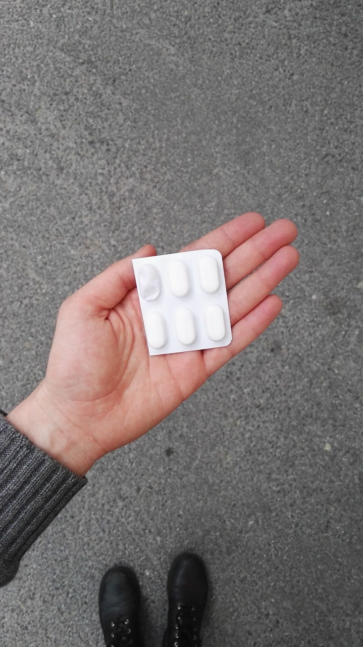 pill, medicine, healthcare and medicine, human body part, high angle view, blister pack, personal perspective, directly above, one person, real people, low section, lifestyles, nutritional supplement, close-up, prescription medicine, day, human hand, outdoors, people