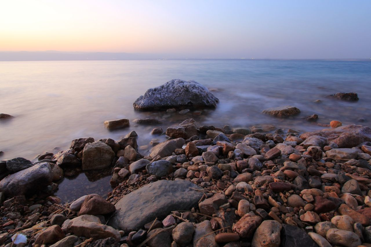 Sea Beach Sunset Pebble Rock - Object Nature Horizon Over Water Tranquility No People Sun Sky Beauty In Nature Rock Rock Formation Outdoors Tranquil Scene Water Scenics Landscape Day Dawn Wave Deadsea Jordan Dead Sea