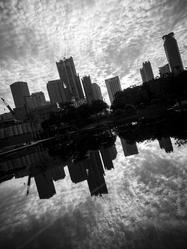 Slanted cityscape in black and white with gloomy clouds reflected in lake Architecture Black And White Buildings City City Life Cityscape Clouds Cloudy Development Financial District  Gloomy Modern Monochrome Monochrome Photography Office Building Reflection Silhouettes Skyscrapers Slanted Sunrise Sunset Urban Skyline Water Waterfront