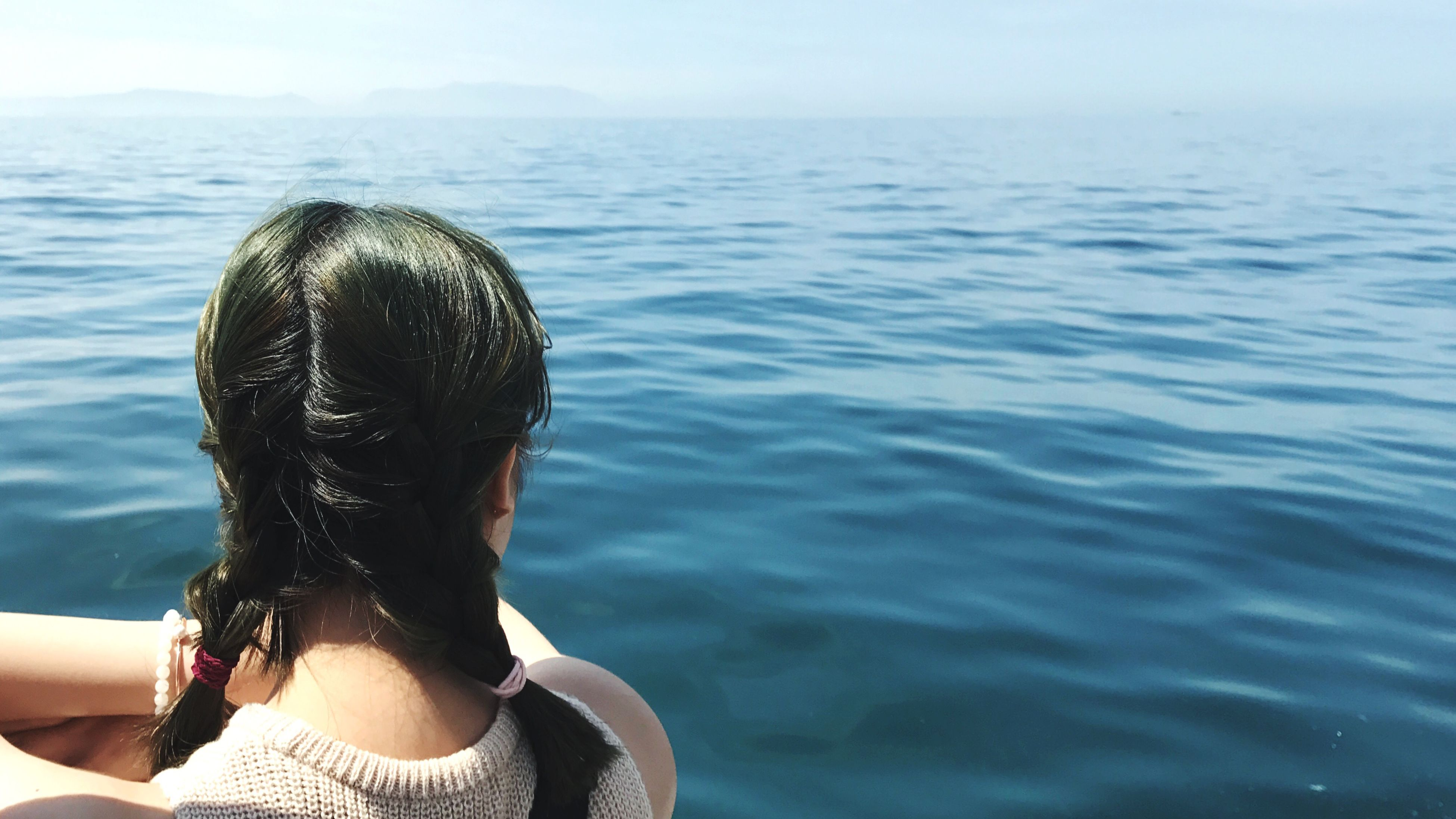 water, one person, lifestyles, sea, real people, leisure activity, rear view, headshot, young adult, day, nature, outdoors, women, sky, young women, close-up, people