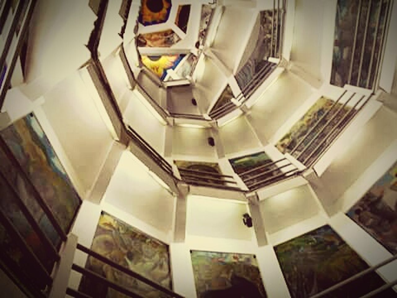 staircase, steps and staircases, architecture, steps, indoors, railing, high angle view, built structure, spiral staircase, no people, futuristic, day
