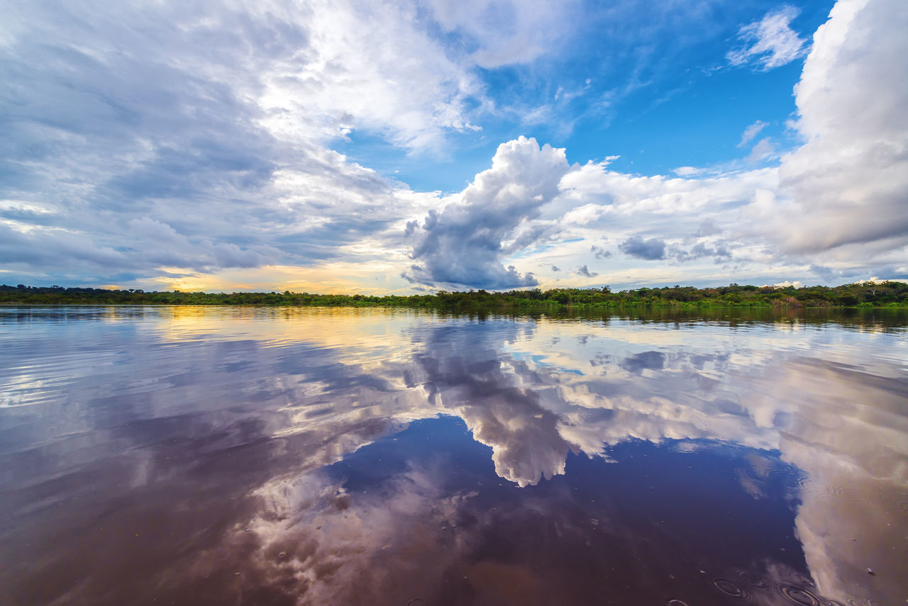 Dramatic sky reflected in the water of the Javari River in the Brazilian Amazon Adventure Amazon Amazonas Amazonia Brazil Cloud Dramatic Sky Flooded Forest Jungle Lake Nature Outdoors Park Rainforest Reflection River Sky South America Tabatinga Travel Tree Tropical Vacation Water