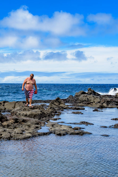 Patriotic bather At the north shore of Maui, you can find beautiful natural pools, right at the ocean's edge. These pools have their own flora and fauna. Here, a tourist wearing the US flag as swimming trunks, enjoys a bath. Adult Uniqueness Beach Full Length Hawaii Leisure Activity Lifestyles Maui Natural Pool North Shore One Person Outdoors Pacific Ocean Patriotism People Real People Rock - Object Scenics Sea Sky Tourist Travel Destinations Vacations Water Enjoy The New Normal Sommergefühle