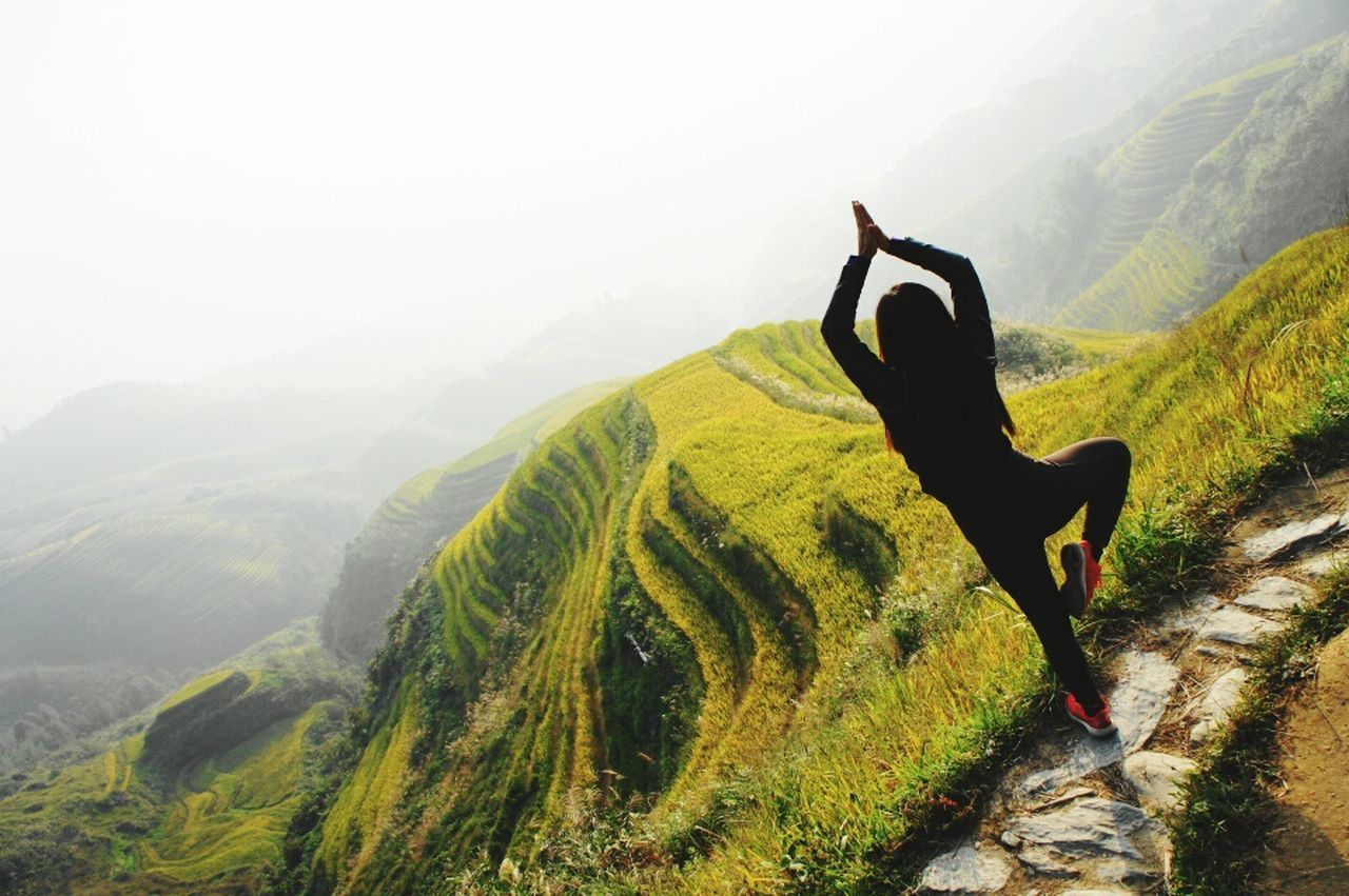 Alternative Fitness The Great Outdoors - 2016 EyeEm Awards Sunrise Yoga in the rice hills of Longsheng China Longsheng Guangxi Guangxi Province Sunrise Silhouette Sunrise Yoga Pose Yoga Yogainspiration Rice Field Travel Photography Wanderlust Travel In China EyeEm Gallery Fitness Healthy Workout