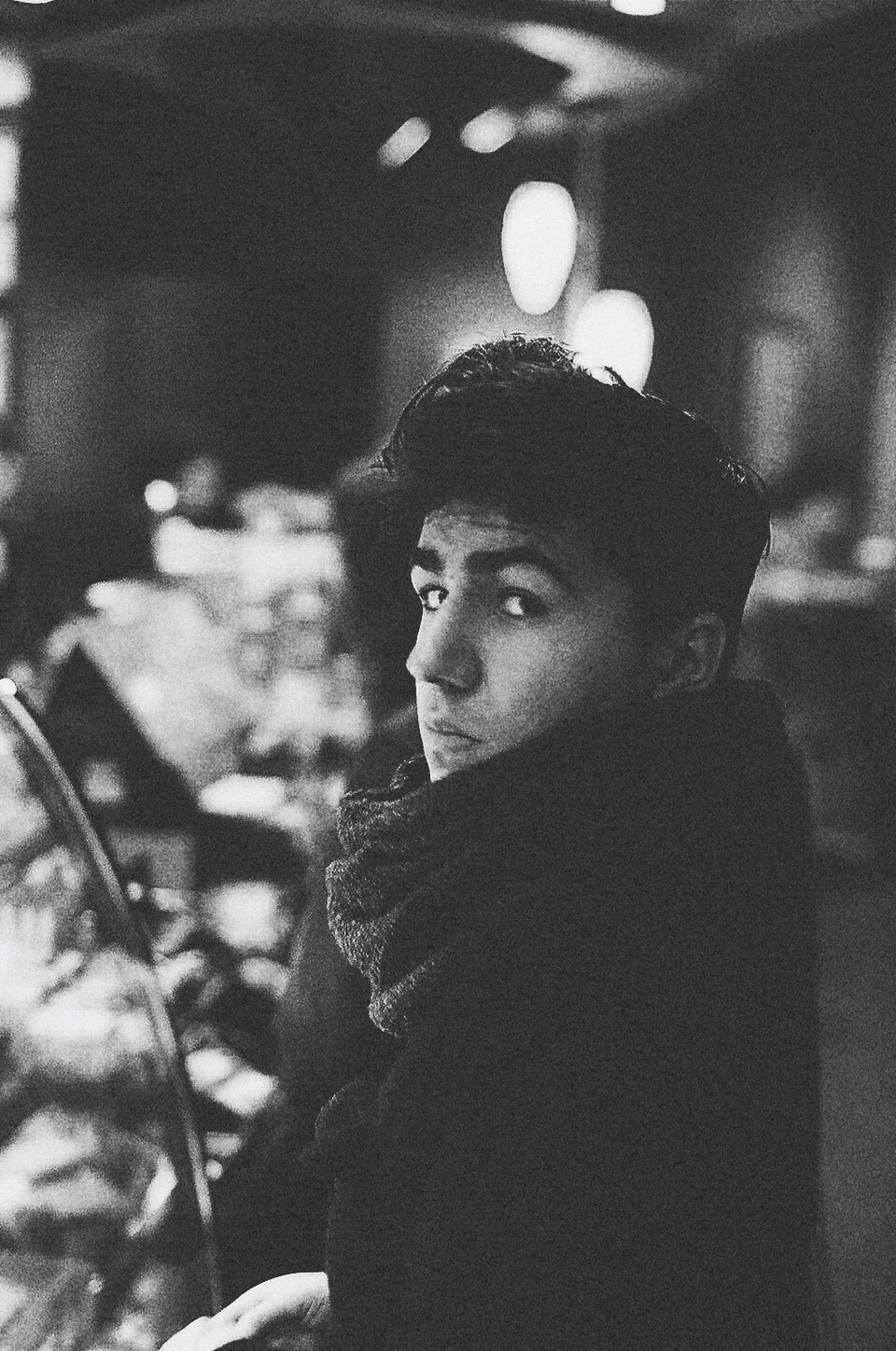 headshot, lifestyles, leisure activity, person, indoors, focus on foreground, young men, portrait, looking at camera, front view, young adult, contemplation, head and shoulders, casual clothing, close-up, night, waist up