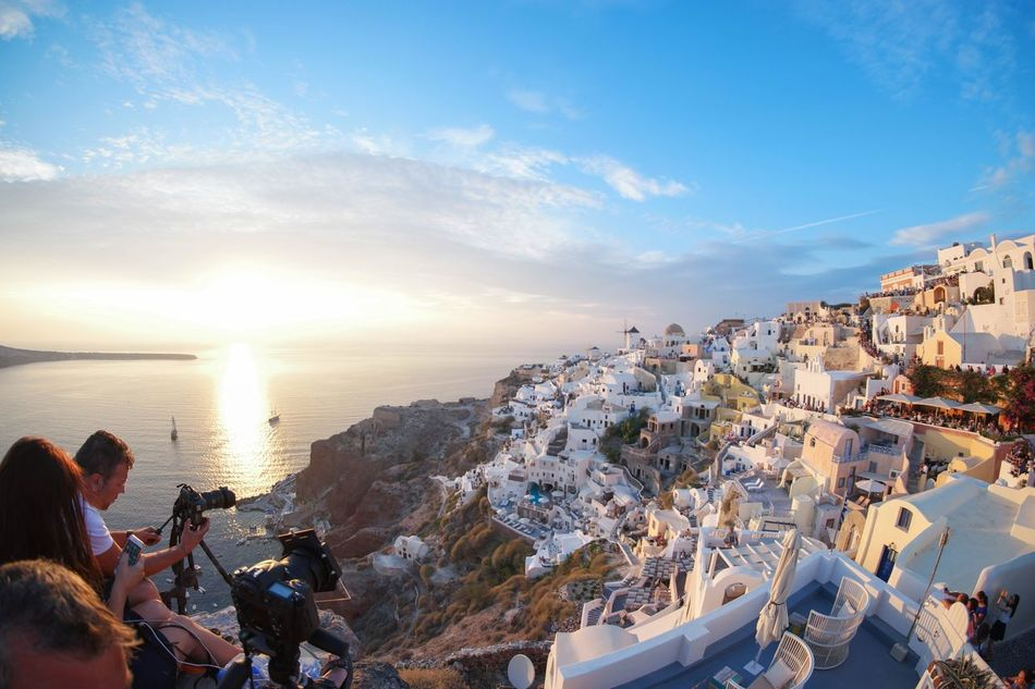 People And Places Water A Bird's Eye View Nature Beautiful Building Exterior Sea Horizon Over Water Sky City Cloud Sun Vacations Cloud - Sky Scenics Landscape Oia Santorini Photographer Sunset