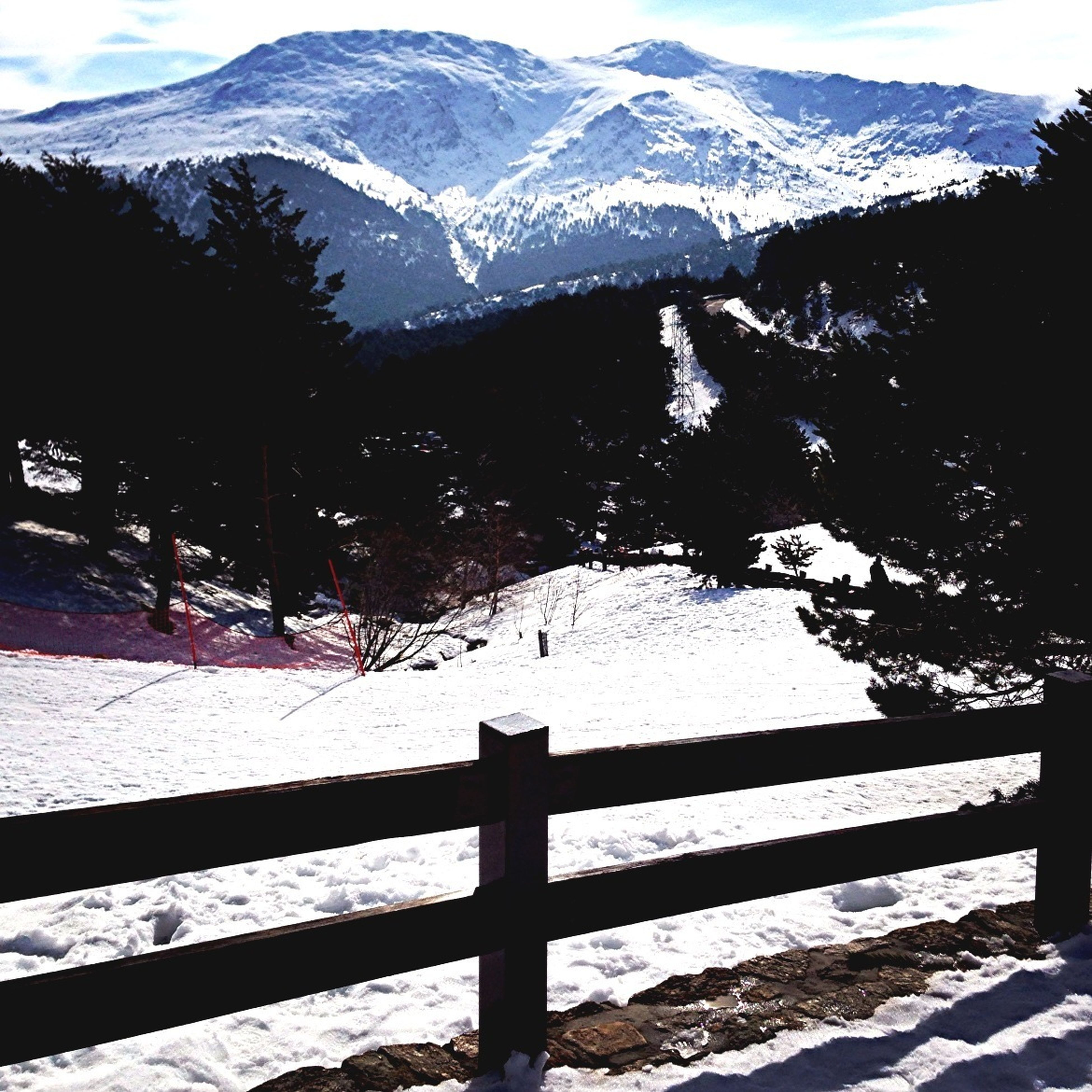 mountain, mountain range, snow, winter, cold temperature, tranquil scene, tranquility, scenics, beauty in nature, season, nature, landscape, snowcapped mountain, tree, railing, weather, non-urban scene, sky, covering, outdoors