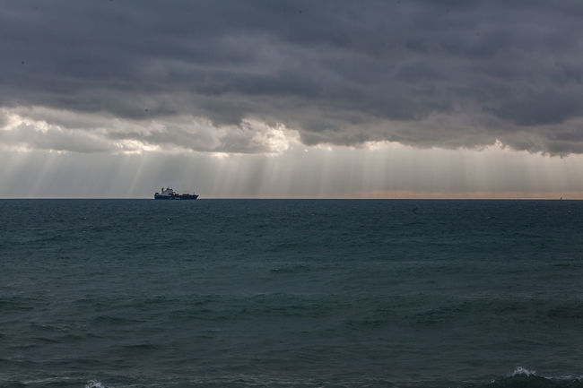 A boat in a stormy weather sea Beauty In Nature Cloud Cloud - Sky Cloudy Dramatic Sky Horizon Over Water Idyllic Nature Outdoors Overcast Remote Rippled Scenics Sea Seascape Sky Sun Sunbeam Sunset Tranquil Scene Tranquility Water Waterfront Wave Weather