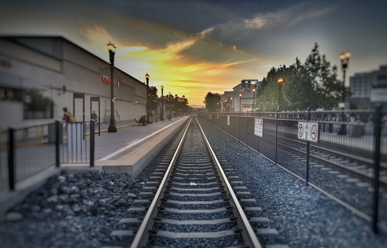 railroad track, transportation, rail transportation, sunset, sky, the way forward, outdoors, no people, cloud - sky, built structure, architecture, building exterior, day